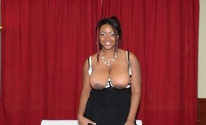 Overweight black woman Selenna pulls her big natural tits out of her dress