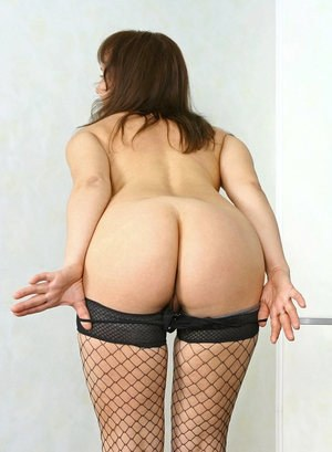 Mature lady Lana strips to mesh stockings in her home office