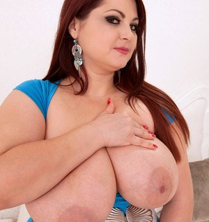 BBW Ann Calis frees her massive tits from her bra and dress as she undresses