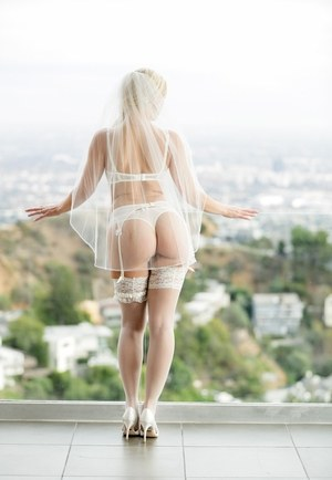 Hot blonde Anikka Albrite removes her bridal veil as well as bra and panties