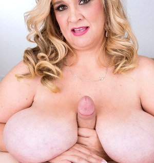Blonde BBW Cami Cooper applies whip cream to a cock while giving a blowjob