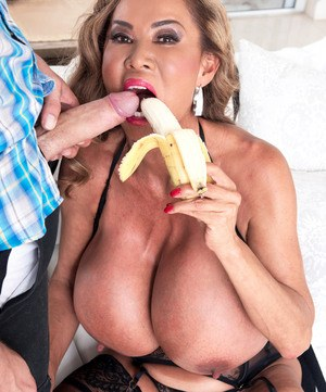 Older Asian pornstar Minka gets fucked by a younger man in black nylons