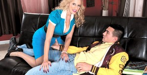 Older blonde lady Holly Claus works her seduction magic on a younger man
