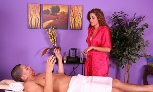 Brunette masseuse Isis Taylor gives her client a blowjob with his massage
