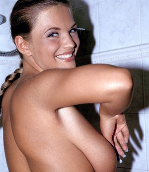 Naked model Ines Cudna wets up her nice melons in the shower