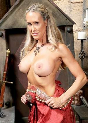 Mature blonde woman Brandi Love frees her big tits from cosplay costume
