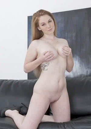 Pale redhead Bre Pheonix uncovers her nice tits before pinching her nipples