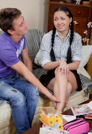 Tiny brunette teen Nelly J is seduced and stripped by her boyfriend
