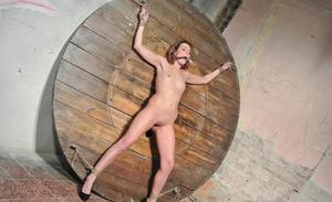 Naked chick Samantha Joons is tied to a wall and forcefully masturbated
