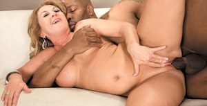 Mature woman Cali Houston fucks her younger black lover