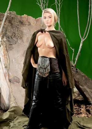 Blonde female Amanda Tate strips off her medieval cosplay outfit