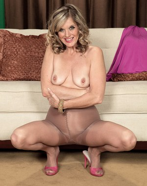 Hot older lady Cami Cline shows off her ass and twat in crotchless pantyhose
