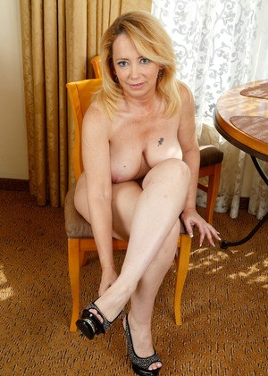 Older woman Brandie Sweet slips off her high heels to finish getting naked