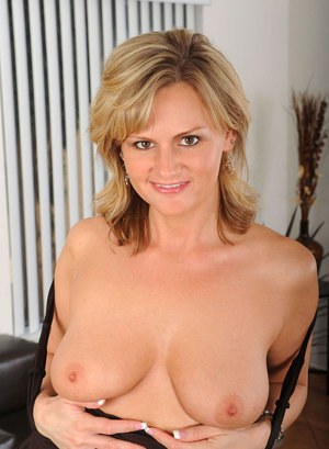 Middle aged blonde lady Becca Blossoms disrobes to masturbate after work