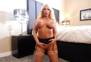 Older MILF Alura Jenson exposes her big boobs and butt wearing stockings
