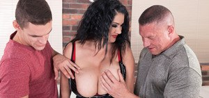 Brunette chick with huge breasts sucks one guy's dick while fucking another
