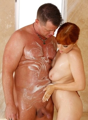 Redhead masseuse Penny Pax strips a businessman naked and takes him into a tub