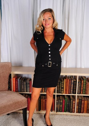 Mature woman Lexxi Lash does a slow striptease before parting her labia lips