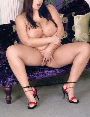 Fat female Kerry Marie hikes off her red dress and panties to toy her twat