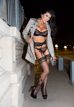 Lingerie model Romi Rain takes to the streets to flash in a trench coat