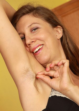 Tall older woman Valentine shows off unshaven underarms and vagina