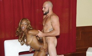 Ebony female with a round ass and red hair gets fucked hard by a white man