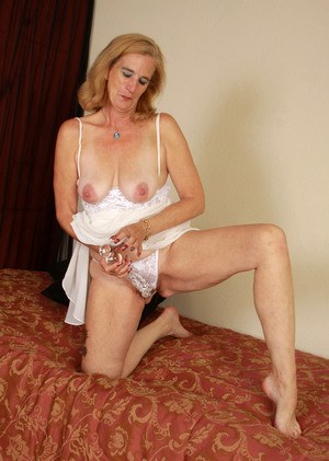Older lady with saggy tits masturbates with some help from a huge dildo