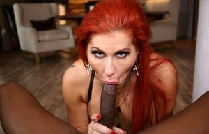 Redhead chick Savana Styles gets mouth fucked by a big black dick