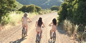 Real life dykes go for a nude bike ride down a country road