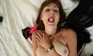 Mature redhead spreads her asshole and pussy in black nylons and heels