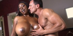 Black chick Melissa Reed seduces a man with her huge all natural boobs