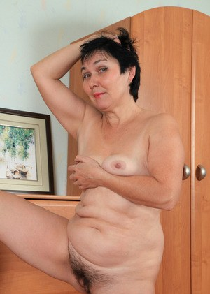 Mature plumper slips out her skirt and pretties to show off her hairy muff