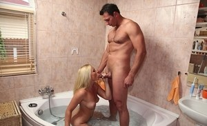 Naked blonde chick Kathia Nobili gives a blowjob while taking a bath
