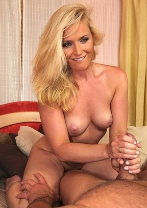 Naked blonde chick Kathia Nobili jerks on a cock after a blowjob