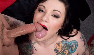 Tattooed BBW Scarlet LaVey sucks a cock with her big tits on the loose