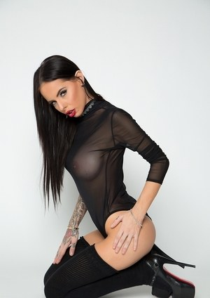 Dark haired beauty Brandy Aniston uncovers her big tits wearing black hosiery