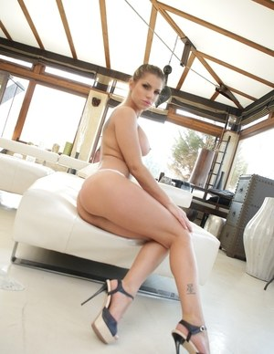 Bare legged solo girl Angel Rivas bares her firm tits and then her phat ass