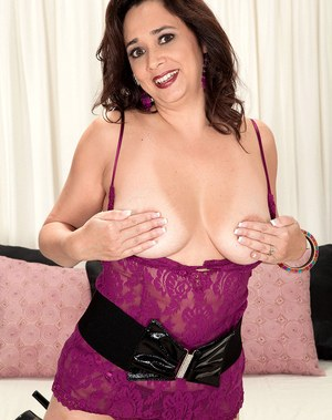 Sexy middle-aged lady Alesia Pleasure flaunts her boobs before masturbating