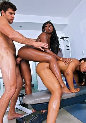 Ebony chicks Sierra Banxxx & Imani Rose oil up big butts before a threesome