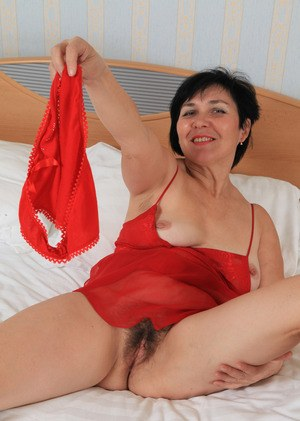Older lady Yulya casts her red panties and lingerie aside to model in the nude
