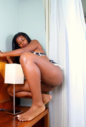 Ebony amateur takes off her matching lingerie ensemble before pussy petting