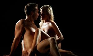 Hot couple make passionate love to each other in a dark room