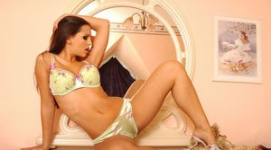 Sexy solo model Eve Angel removes her satin bra and panties afore a mirror