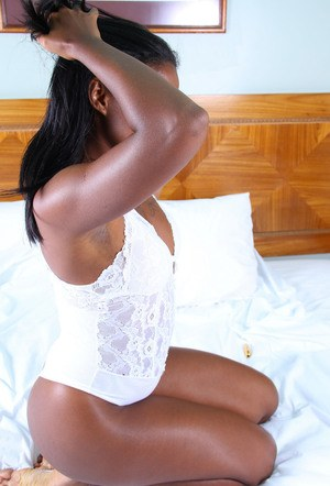 Ebony solo girl Nicole spreads her labia lips after removing white lingerie