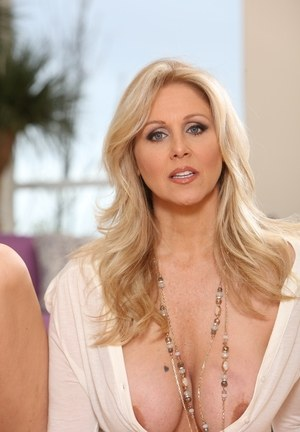 Blonde solo model Julia Ann lets her nipples fall loose from clothing