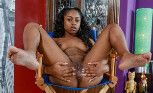 Petite black amateur Amilian Kush showcases her bald cunt after undressing