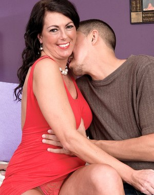 Hot middle-aged lady Dakota Riley gets a creampie from a younger boy