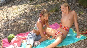 Young girls Blue Angel and Yasmine Gold have lesbian sex on rocky beach road