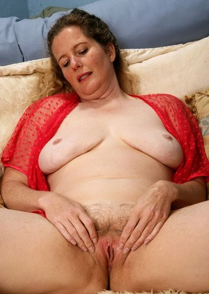 Chubby older woman pulls down her lace panties to show the pink of her beaver