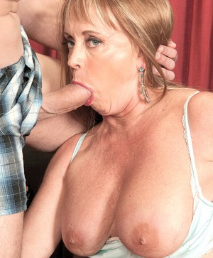 Busty nan Lexi McCain gets a cum facial after seducing and blowing young guy